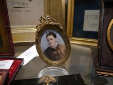 19th century portrait miniature of a lady, bearing cypher GE, watercolour on ivory, within a