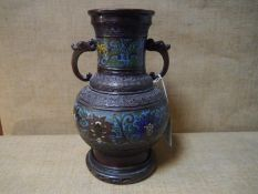 A Chinese bronze and cloisonne enamel twin-handled vase, c. 1900, of baluster form, with