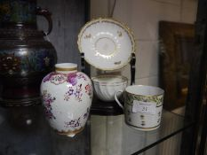 A Derby porcelain tea bowl and saucer, early 19th century, wrythen and moulded, decorated with