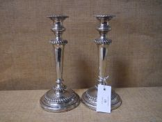 Pair of Edwardian silver candlesticks, Sheffield 1901, each with removable drip pan above a