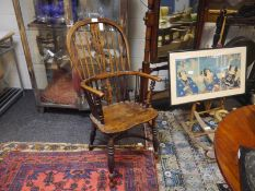 Elm Windsor armchair, mid-19th century, with pierced scroll-carved splat above a dished seat, raised