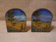 Pair of painted pokerwork bookends, in the Art Nouveau taste, each impressionistically painted