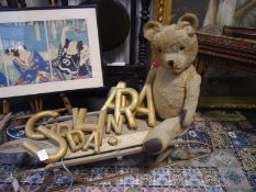Large vintage teddy bear, with glass eyes, leather pads to paws and articulated limbs. 84cm