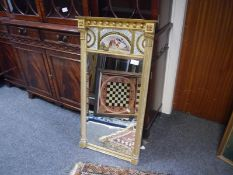 Regency gilt-composition pier mirror, of architectural form, the rectangular bevelled plate