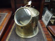 Brass lifeboat compass, early 20th century, contained in a brass binnacle with ring carrying handle.