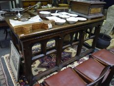 Late 19th century oak altar table, the rectangular top raised on chamfered legs joined by carved