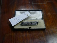 Diamond and sapphire bar brooch in the Art Deco taste, pave set with geometric panels of diamonds