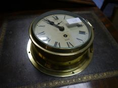 J.W. Searby & Co., Lowestoft, a brass-cased ship's clock, by Sestrel, with subsidiary dial and