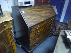 George III mahogany bureau, of characteristic form, the slope enclosing a fitted interior above four