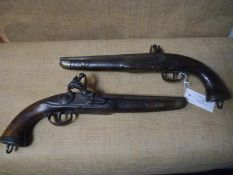 Pair of brass mounted walnut flintlock pistols, circa 1800, each with plain steel lock plate, one
