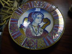 Late 19th century Italian maiolica charger, lustre glazed, painted to the well with the bust of a