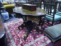 Boulle work loo table in 19th century style, the scalloped oval top with gilt-metal mounted border