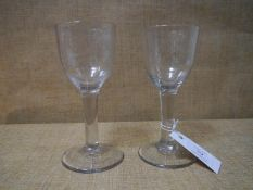 A matched pair of 18th century wine glasses each with ogee bowl on plain stem with conical foot,