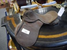 Early 20th century miniature leather saddle, possibly a salesman's sample. Length approx. 27cm