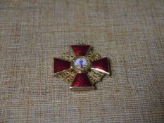 Russian Imperial Order: the Cross of St. Anne, red guilloche and coloured enamels, mounted in 14ct