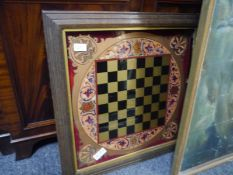 19th century reverse painted glass chequerboard, framed.