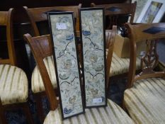 Pair of Chinese silk needlework sleeve panels, early 20th century, framed. Each 50.5cm by 10.5cm