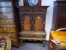 19th century oak, part-ebonised cabinet on stand in the Flemish taste, the upper section with a pair
