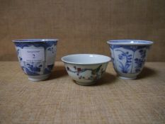 Three Chinese porcelain tea bowls, one painted with birds on flowering boughs and with six character