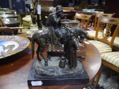 Alfred Dubucand (1828-1894), a patinated bronze figure group of a mounted arab with a female water