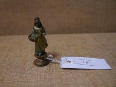 Cold painted bronze desk seal, probably Austrian, modelled as a young flower seller, 7.3cm