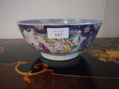 Chinese Export porcelain bowl, c. 1800, in the famille rose palette, painted with cartouches
