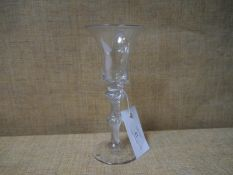 18th century air twist glass, with trumpet bowl above a double-knopped multi spiral twist stem, on a