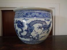 Chinese blue and white porcelain jardiniere, painted with dragon, bats and flowering boughs. 29.