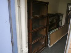 Globe Wernicke oak sectional bookcase, of characteristic form, with four sections and ivorine