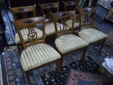 Set of Dutch or North German brass inlaid elm dining chairs, c. 1820, each with inlaid tablet
