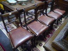 Set of six Regency parcel-gilt mahogany rope twist dining chairs, comprising five side chairs and