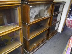 Globe Wernicke oak sectional bookcase, of characteristic form, in three sections, bearing maker's