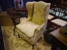 George III style mahogany framed wing chair, c. 1900, with scrolled crest rail and loose cushioned