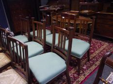 Set of six mahogany dining chairs in the Arts and Crafts taste, each back with capped uprights and