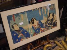 Triptych of Japanese Kabuki actors, 19th century, three woodblock prints, signed, framed; on an