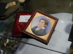Late 19th century portrait miniature on ivory of a young boy, formally dressed in pink tie,