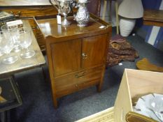 George III mahogany commode cupboard, the rectangular galleried top above a pair of cupboard doors