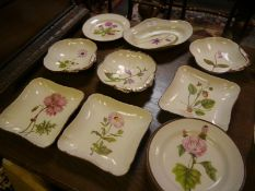 Early 19th century English creamware botanical dessert service, the painted studies taken from