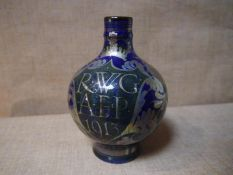 Pilkingtons Royal Lancastrian a lustre glazed flagon, glazed in blue and green and painted with a