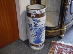 Chinese blue and white porcelain stick stand, painted with exotic birds amidst flowering boughs