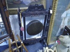 Late Victorian oak framed dinner gong, with scroll and leaf carved crest, baluster uprights and