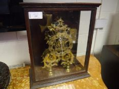 Mid-19th century brass skeleton clock, with engraved scalloped chapter ring, Roman numerals, fusee
