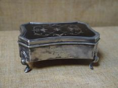 George V silver and tortoiseshell jewellery box, Birmingham 1911, of shaped rectangular form, the