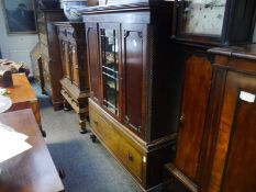 19th century mahogany side cabinet, the upper section with glazed doors flanked by panelled doors,