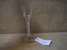 18th century air twist glass, with panelled bowl on a double spiral stem, on a conical foot. 15cm