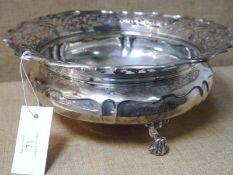 Edwardian silver fruit bowl, London 1903, of bellied form with everted scalloped rim, pierced with