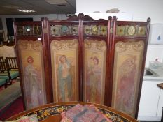 Striking mahogany-framed painted and coloured and leaded glass four fold screen in the Art Nouveau