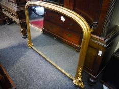 Giltwood overmantle mirror in 19th century style, with arched top and scroll-carved base. 0.90m by