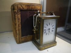 French late 19th century brass-cased carriage clock, the white enamel dial with Roman numerals, in