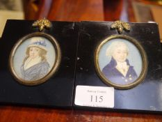 Pair of portrait miniatures of a lady and gentleman, c. 1800, the gentleman in brass-buttoned blue